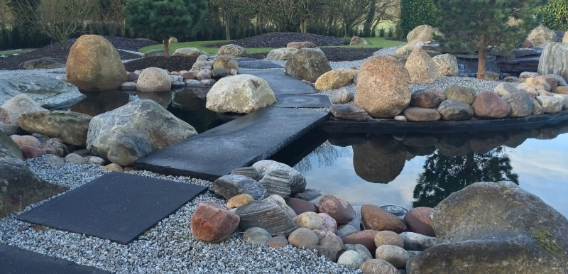 Pond filter systems cleans maintenance and relines from for Large pond maintenance